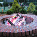 Brick fire pit: natural wood