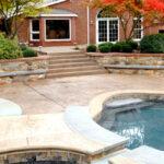 Caesar-stone pattern colored concrete pool deck