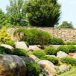 Boulder outcroppings and Ironstone masonry walls