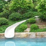 Safe in-ground slide through garden views
