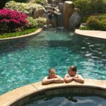 Swimming pools, waterfalls and built-in hot tubs are a magnet for grandkids