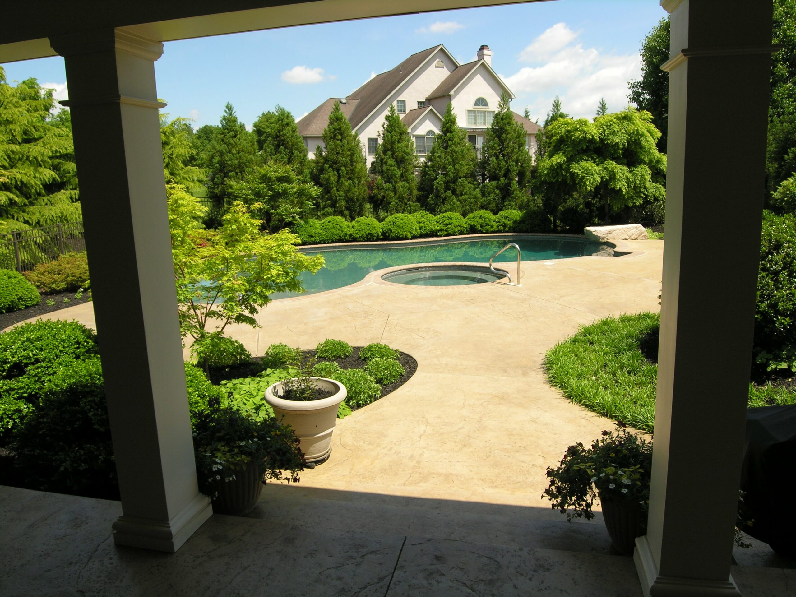 Deep porch frames view of private swimming pool oasis, Lancaster, PA