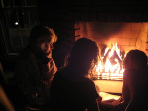 Children read by outdoor fireplace, Lancaster, PA