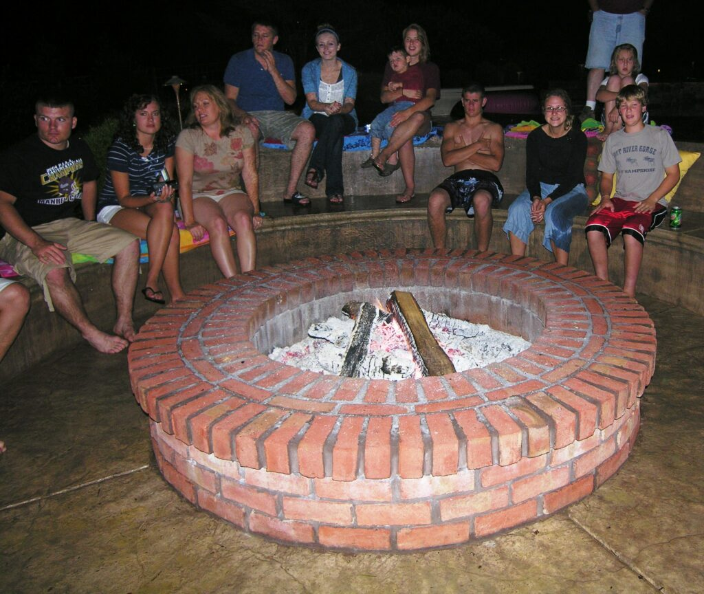 Brick fire pit with layered seating terraces on uphill side, Lancaster, PA