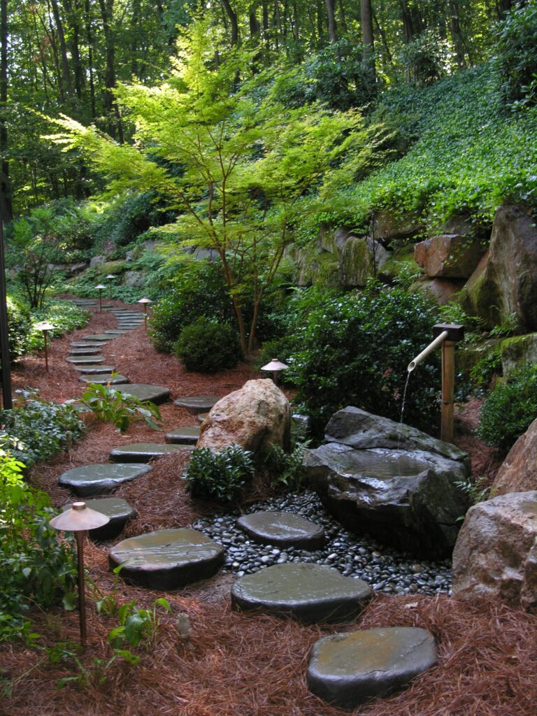 Hand-shaped Bluestone stepping stones create interesting path, while solving difficult drainage problem in flat, backyard garden, Lancaster, PA