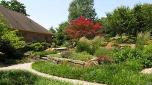 Rustic stone terraces complement flowing meadow garden in farm country, Morgantown, PA