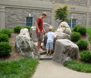 "Children explore ""canyon"" of natural boulders, Lancaster, PA"