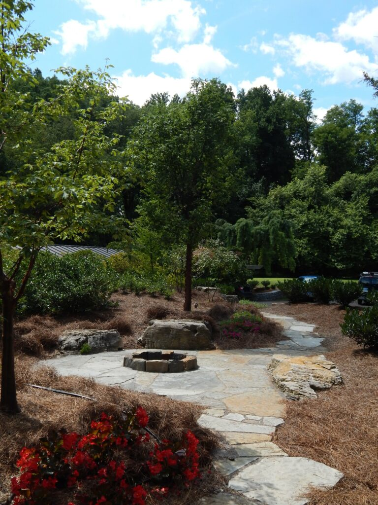 Fire pit and patio tucked in nook beside garden path (in process), Cornwall, PA