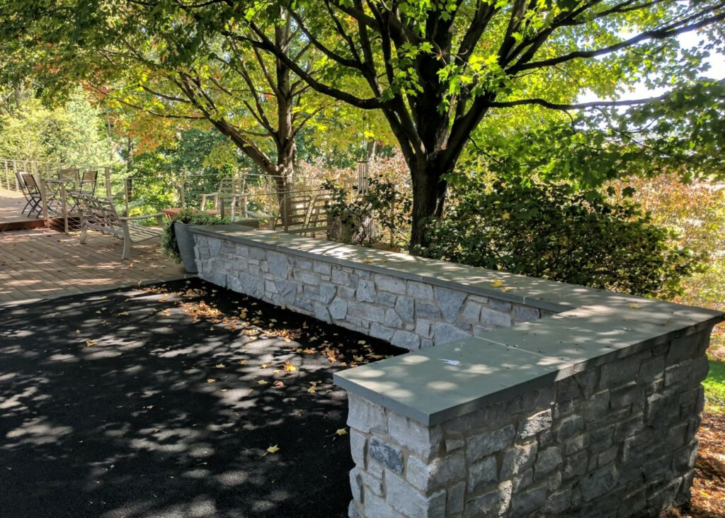 Natural stone seating wall continues clean modern lines of deck, Lititz, PA