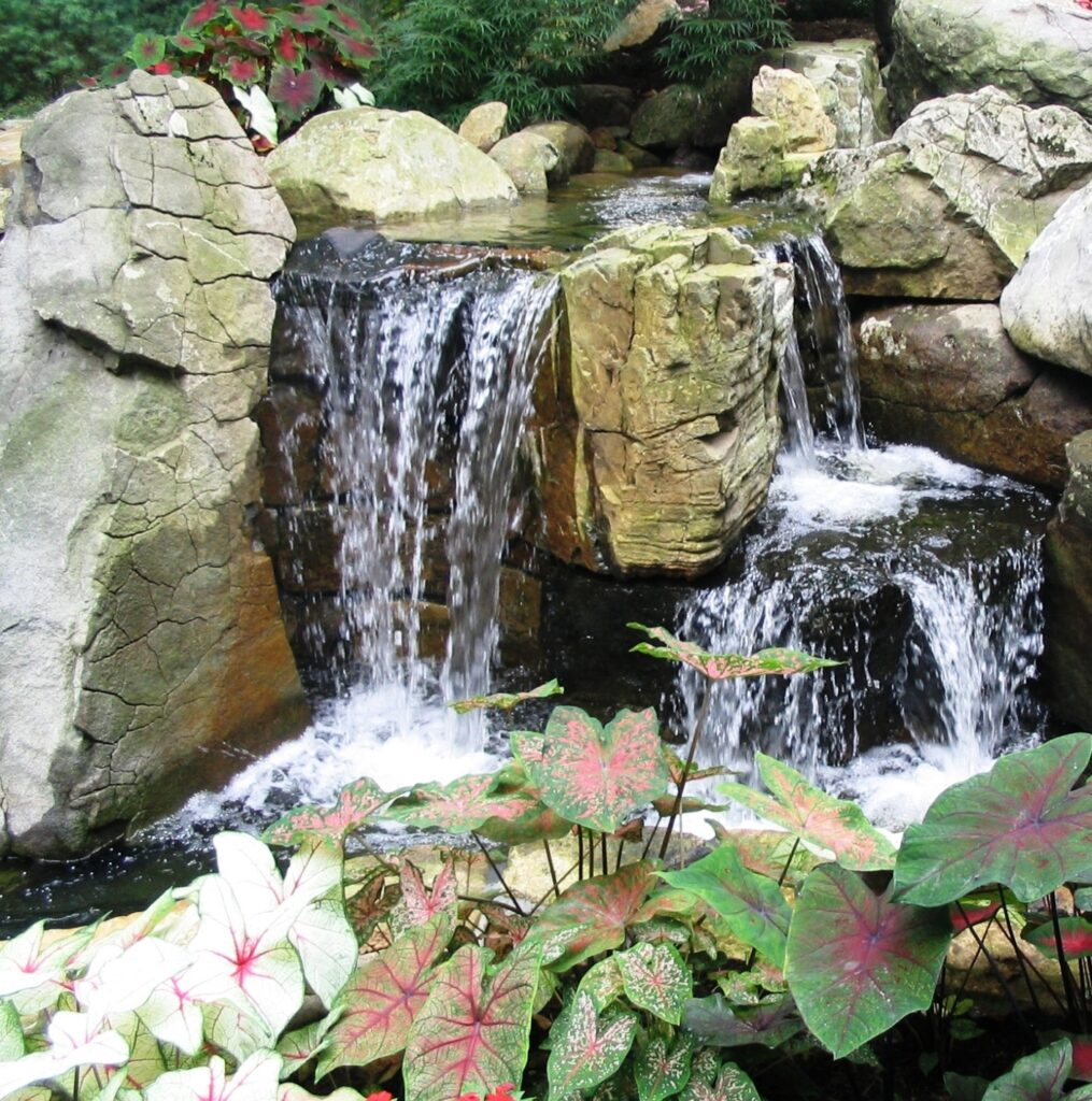 The music of this natural-looking waterfall plays within reach of client's window, Hershey, PA