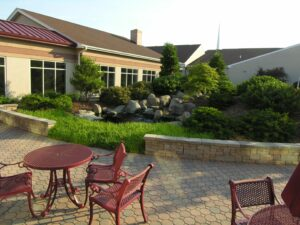 Al fresco dining terrace with seating wall and water feature, Manheim, PA
