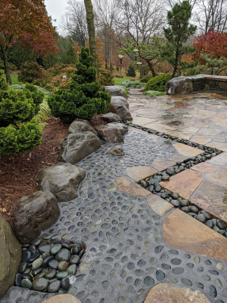 Natural stone drain channel and boulder curb removes puddles, prevents erosion in heavy rains and is a safe place to step, Lititz, PA