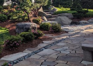 Boulders support stone staircase from natural stone patio, Manheim, PA