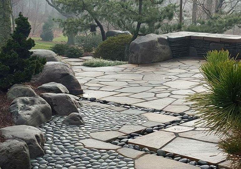 Boulders form retaining wall and patio curb, Manheim, PA