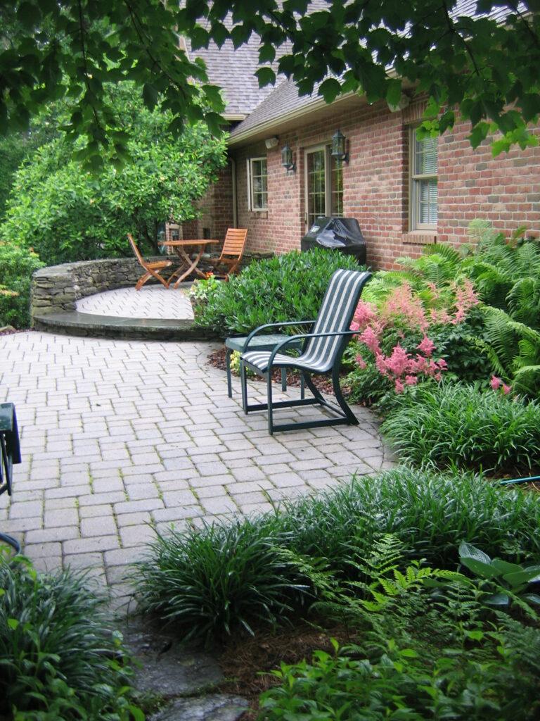 Stone seating walls embrace multi-level patios, Morgantown, PA