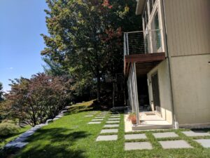 Contemporary Bluestone squares softened by lawn grid, Lititz, PA