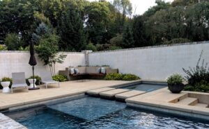 """Modern lines in courtyard with unique, cantilevered bench and """"floating"""" steps across pool, Lancaster, PA"""