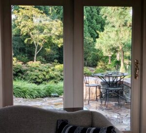 Enjoy intimate weather moments, like the sun peeking out after a summer shower, when your living room displays the garden, Manheim, PA