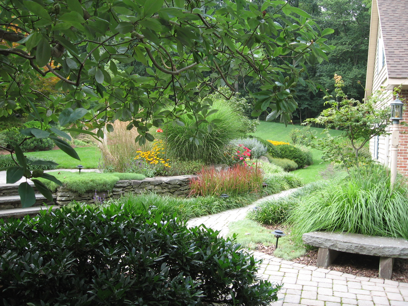 A natural feel to these garden terrace plantings, Morgantown, PA