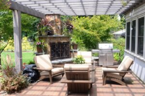 Custom fireplace anchors outdoor room and pergola, Lancaster, PA