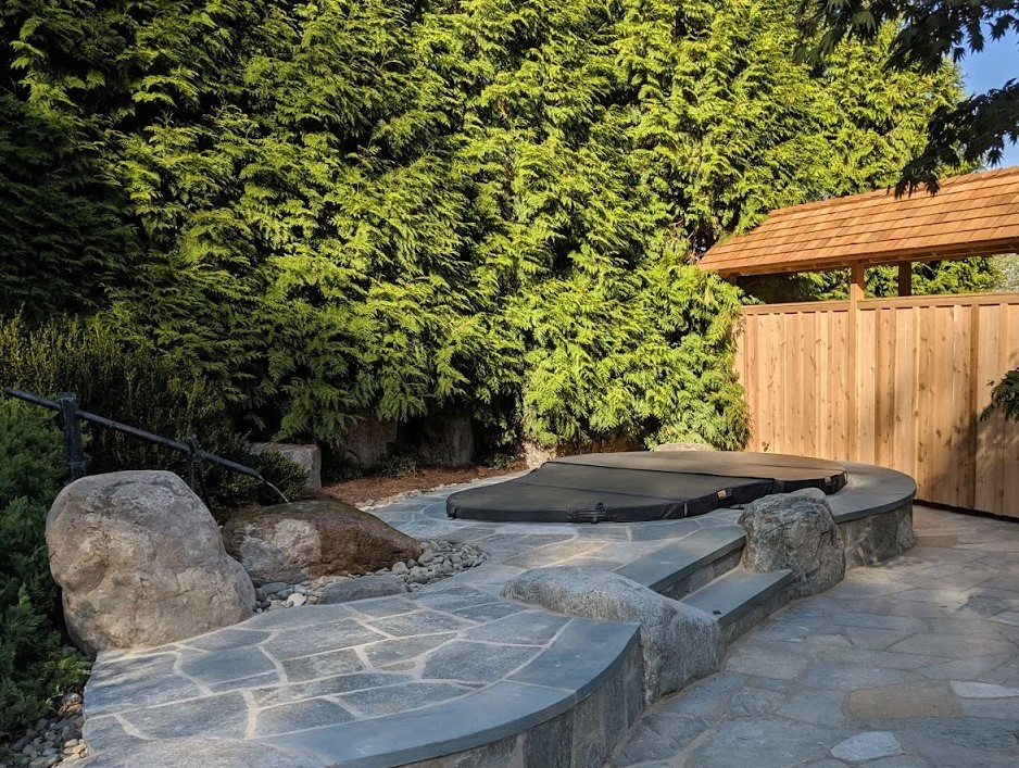 Built-in hot tub terrace with tsukubai water feature also serves as a bench for family, Lancaster, PA