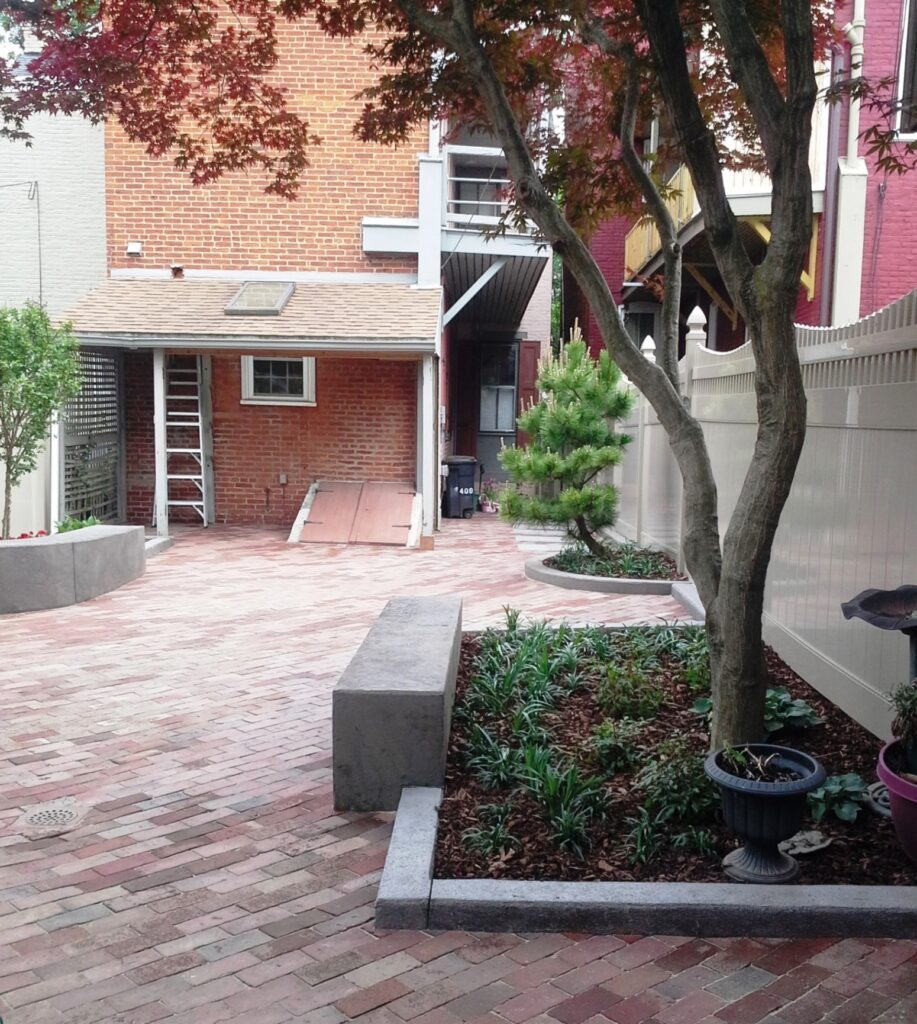 Modern poured concrete curbing and benches add crisp touch to old city courtyard, Lancaster, PA