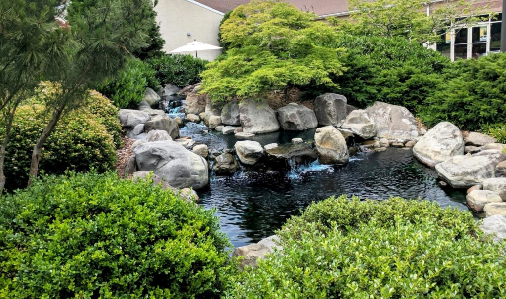 Natural stream water feature inside enclosed courtyard, Manheim, PA