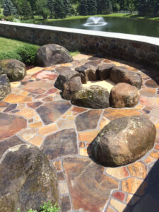 """Custom boulder fire pit with boulder """"benches"""" and natural stone paving, Elizabethtown, PA"""