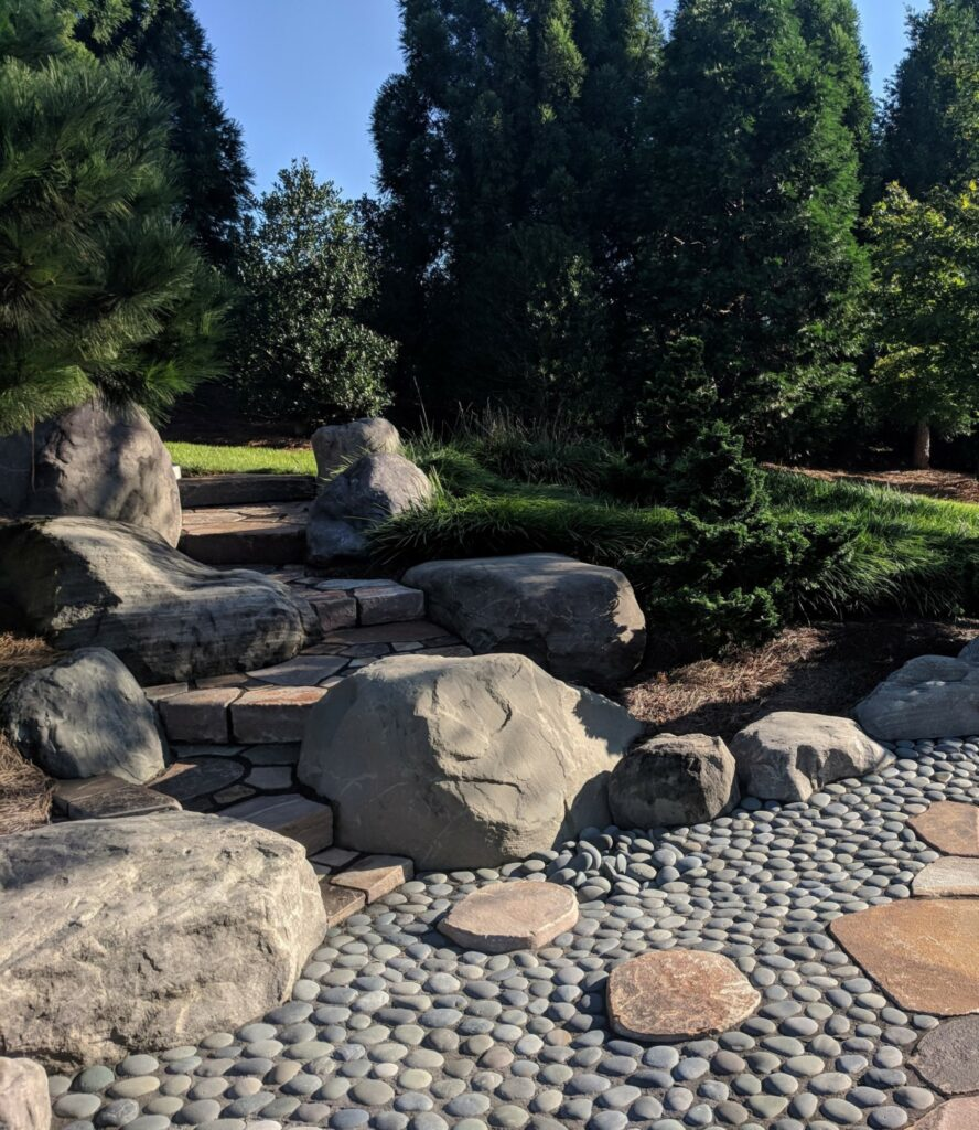 Natural stone staircase connects upper lawn with patio, Manheim, PA