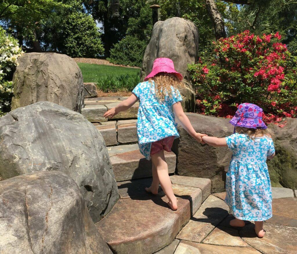 Children enjoy the texture of natural stone under bare feet, Manheim, PA