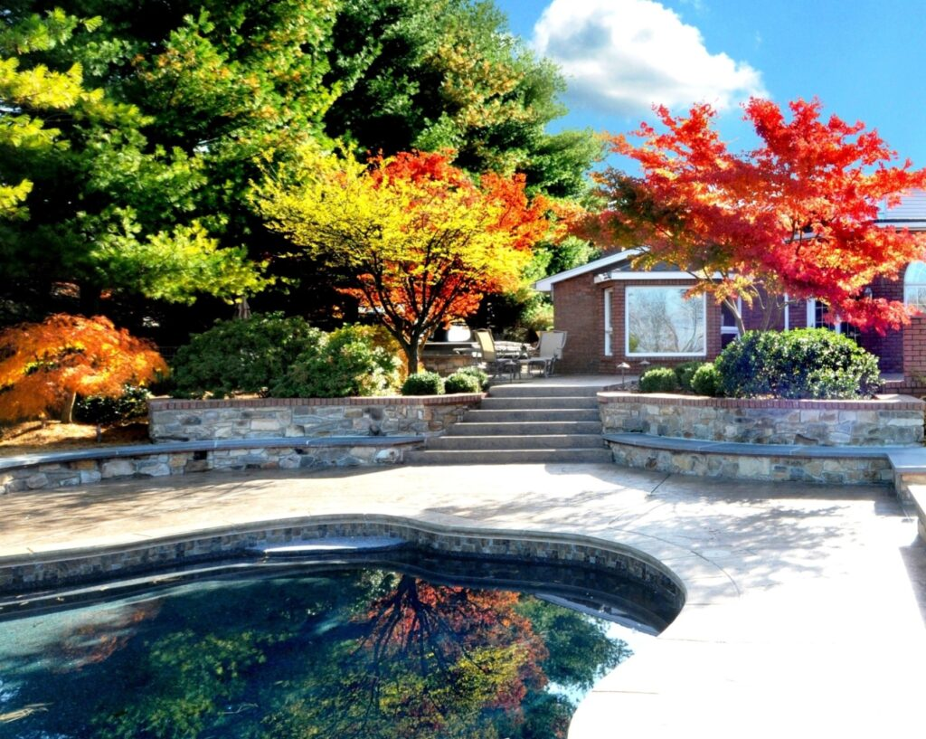 Curved stone seating walls retain garden terraces, Lancaster, PA