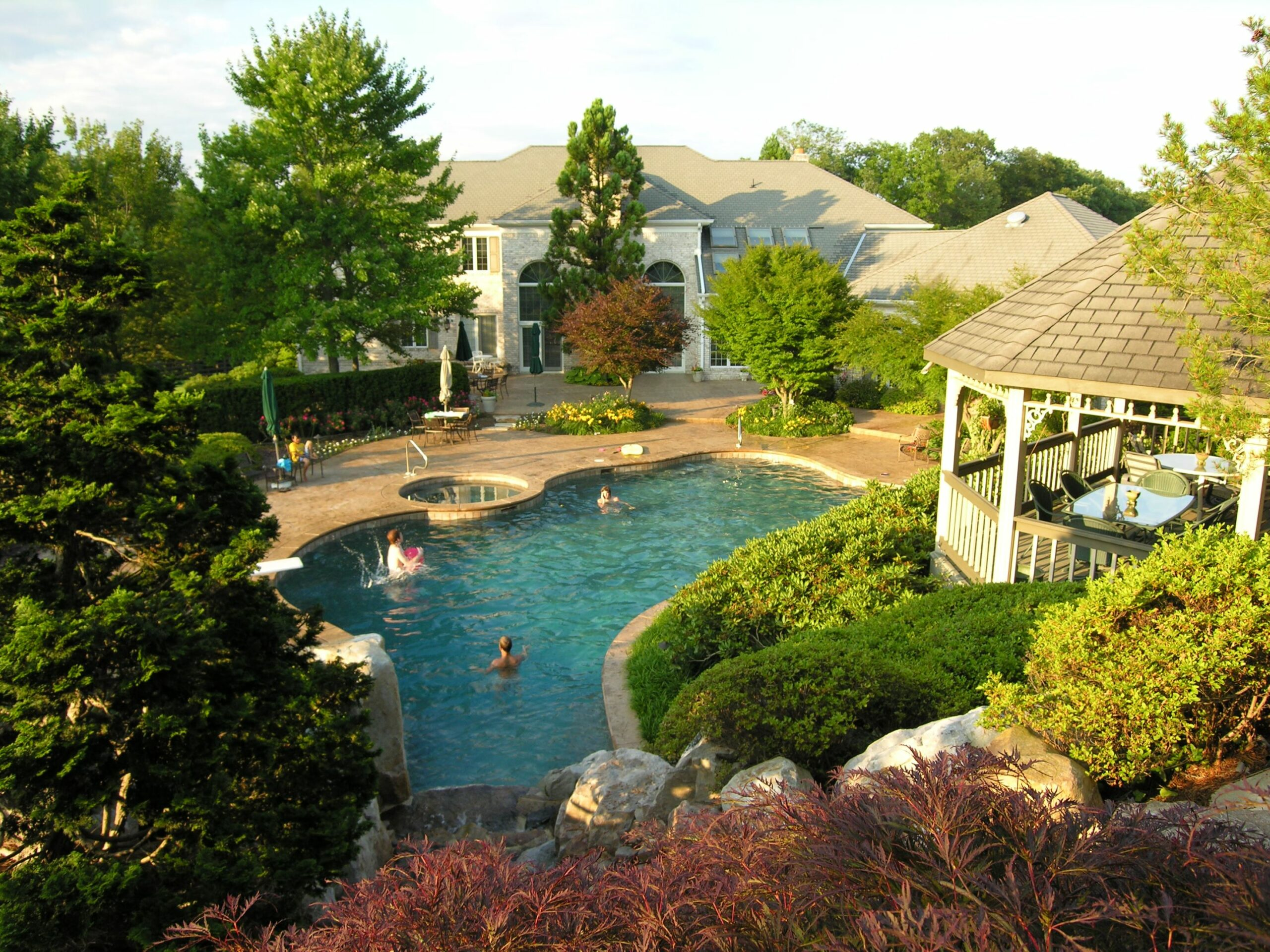 Plantings soften ample patio, bringing life and natural beauty to swimming pool garden, Manheim, PA