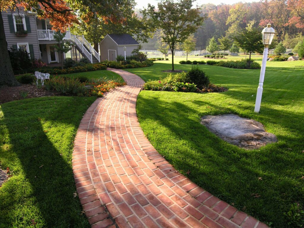 Brick path winds through lawns to restored farm house, Elizabethtown, PA