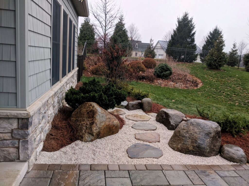 Stepping stone path leads though garden beds to lawn and garden faucet, Harrisburg, PA