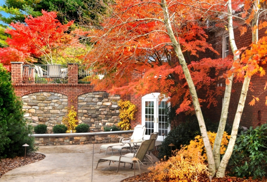 Natural stone and brick terraces bring close the bright fall colors of ornamental trees, Lancaster, PA