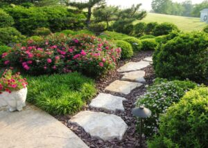 Stepping stone path leads through garden to side lawn, Manheim, PA
